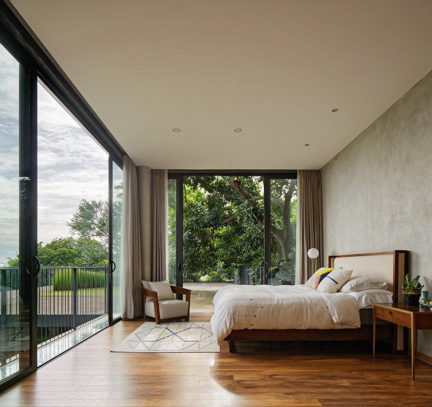 The bedroom on the second floor has a treehouse-like feel.