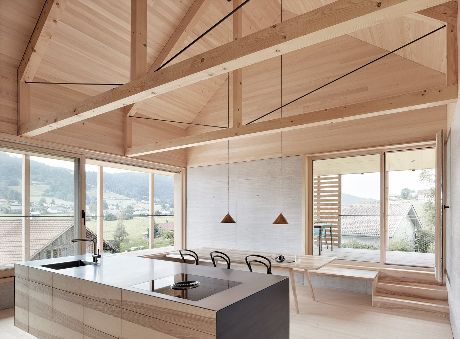 Exposed trusses celebrate the home's timber construction.