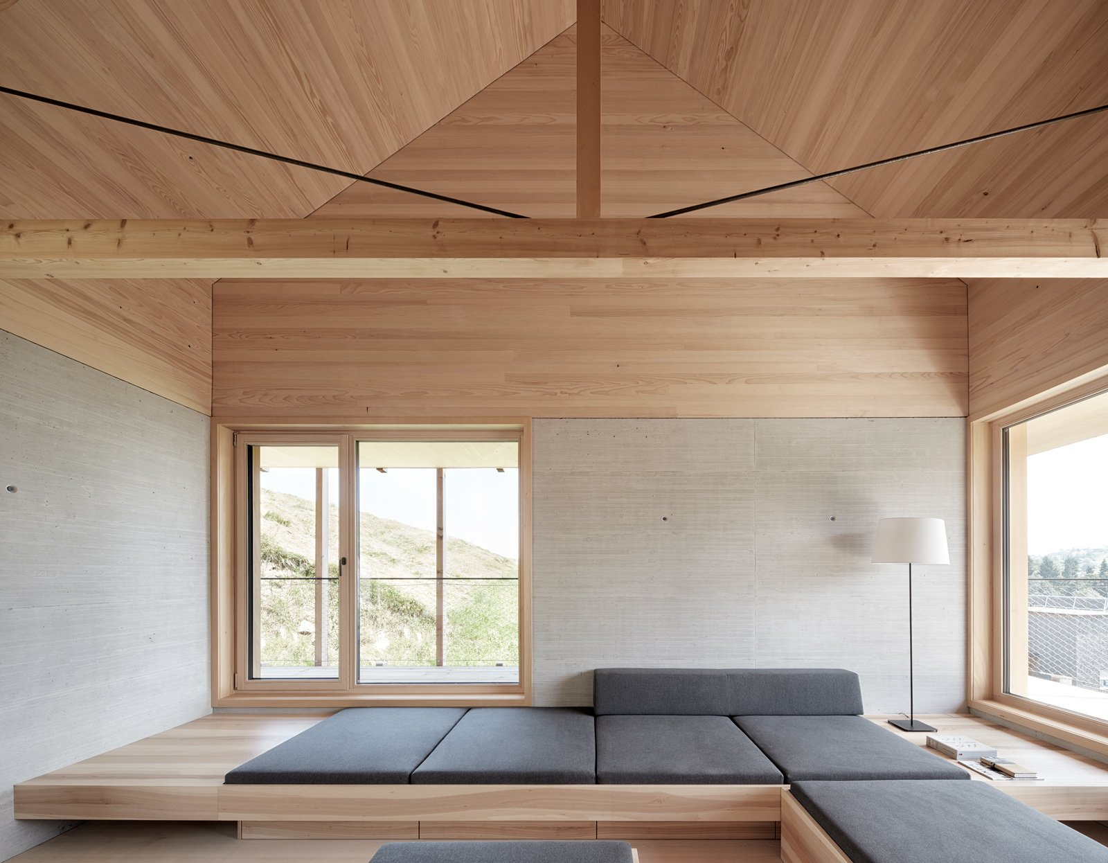 A restrained materials palette gives the minimalist home a crisp and clean appearance.