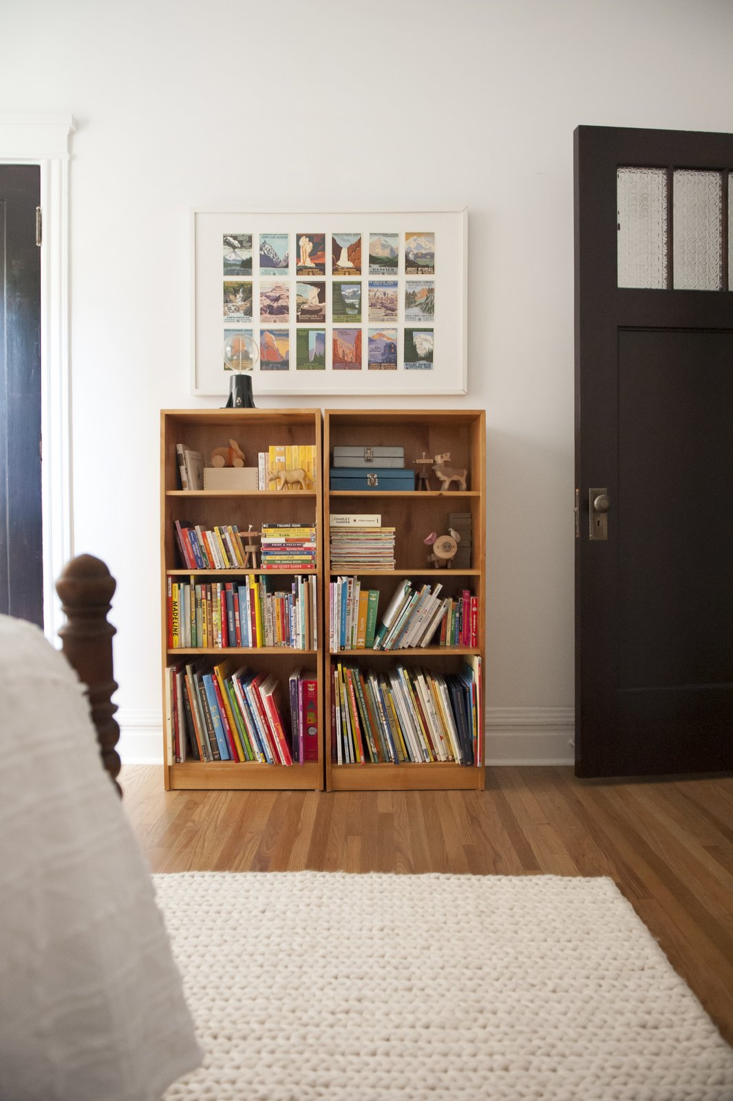 Tagged: Kids Room, Bedroom, Bookcase, Medium Hardwood Floor, Rug Floor, Pre-Teen Age, and Neutral Gender.  Best Photos from Simple and Beautiful Chicago Family Apartment