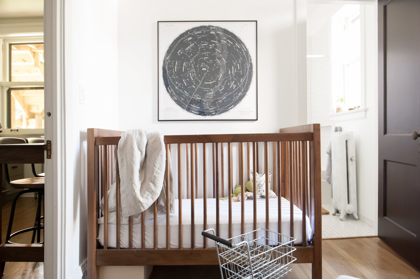 Tagged: Kids Room, Bedroom, Bed, Medium Hardwood Floor, Neutral Gender, and Toddler Age.  Best Photos from Simple and Beautiful Chicago Family Apartment