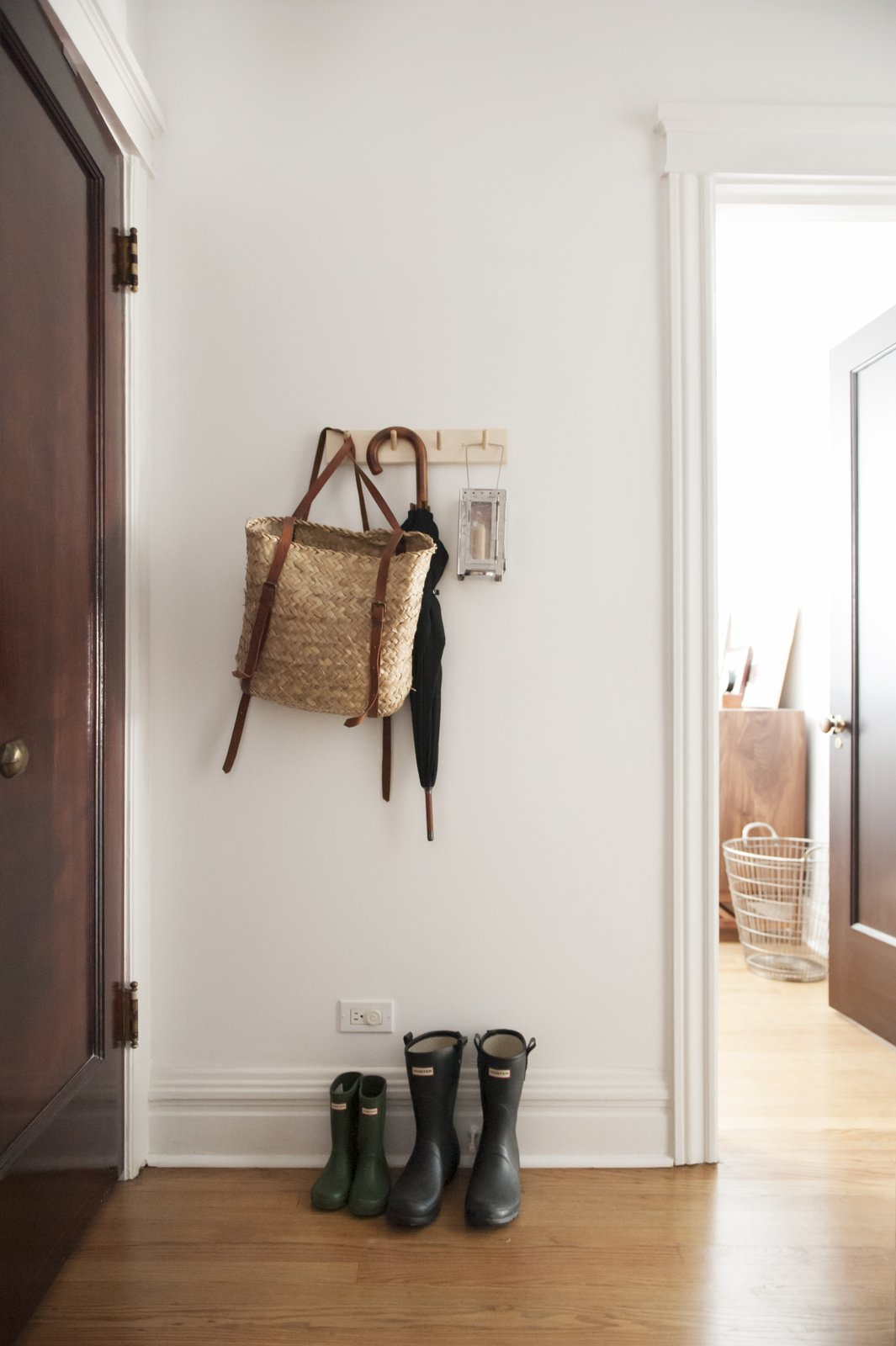 Tagged: Hallway and Medium Hardwood Floor.  Best Photos from Simple and Beautiful Chicago Family Apartment