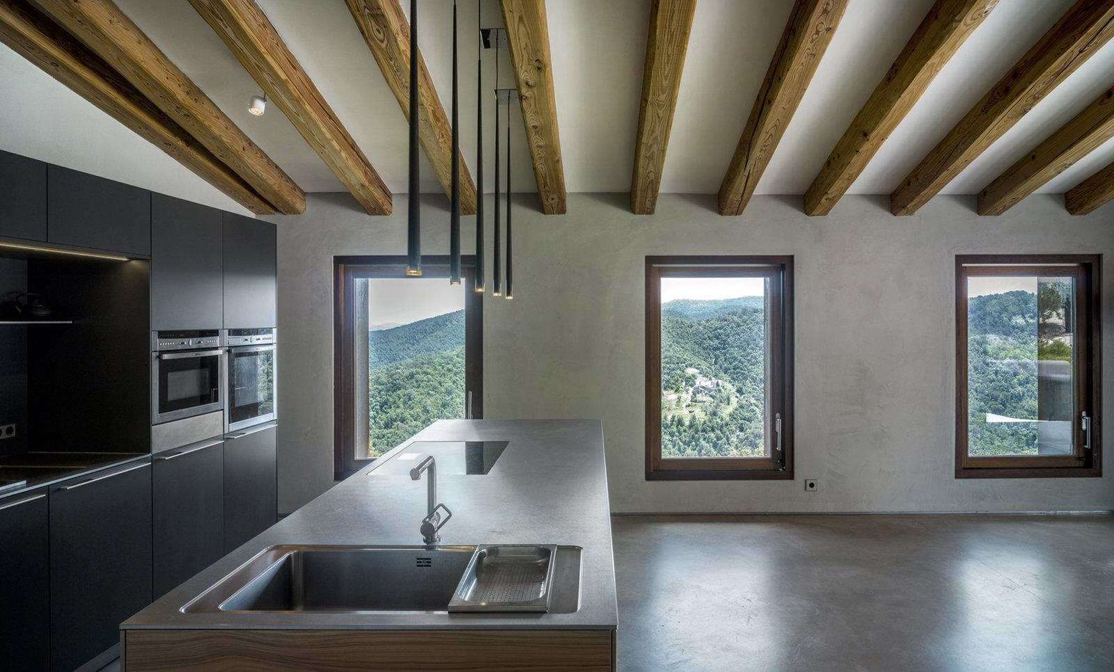 Open kitchen with views-VILLA CP Tagged: Kitchen, Concrete Floor, and Ceiling Lighting.  Best Photos from Villa CP