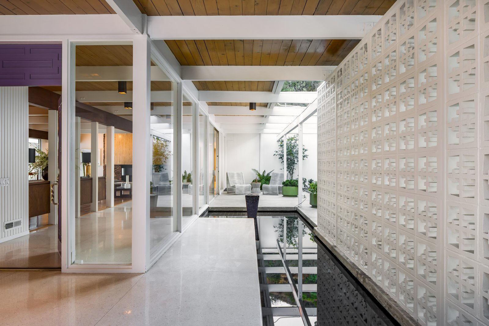 Flooded with natural light, the residence is a warm and welcoming retreat.  Tagged: Exterior, Mid-Century Building Type, and House.  Best Photos from The Brander House