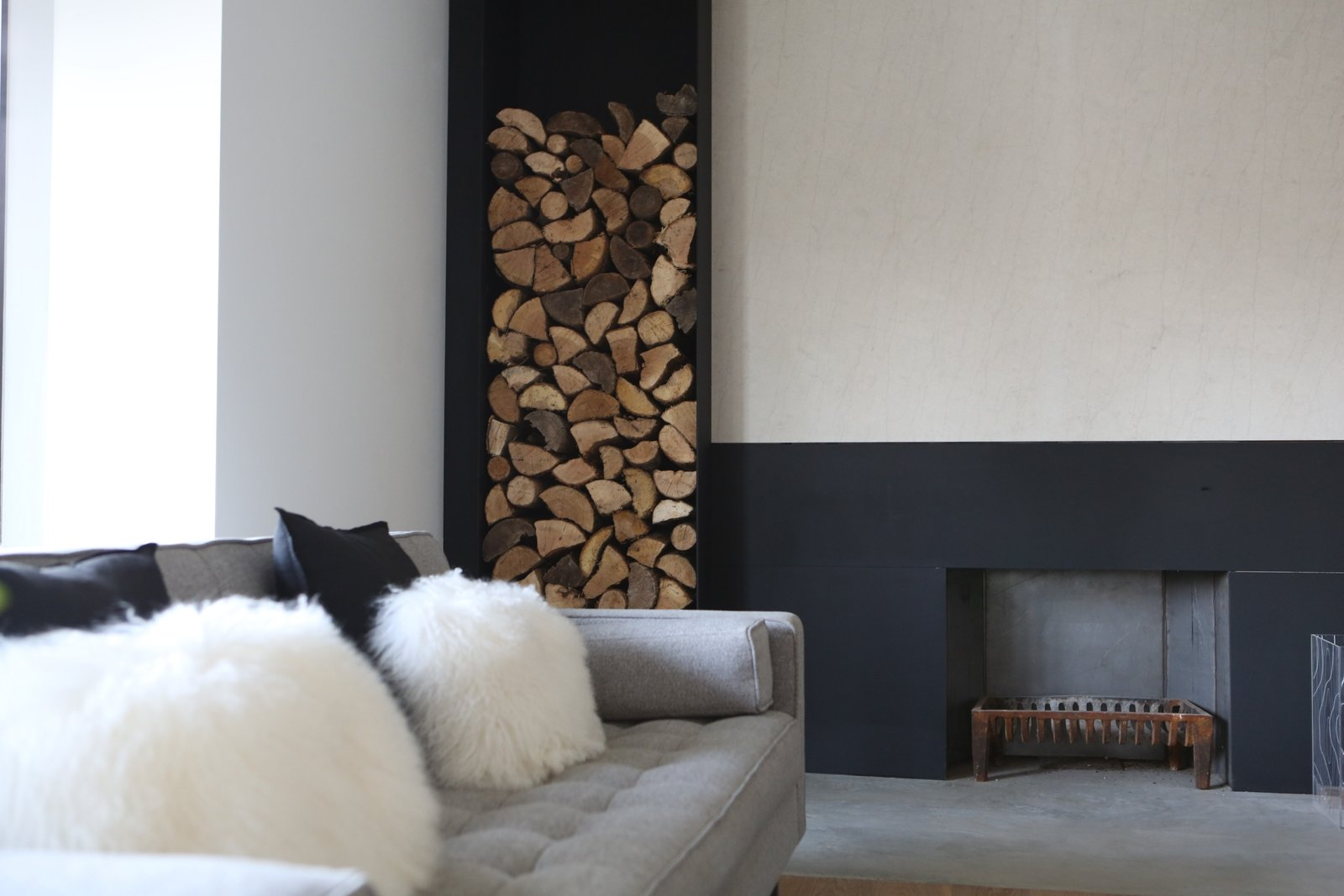livingroom and existing fireplace renovated Tagged: Living Room, Sofa, Concrete Floor, Medium Hardwood Floor, and Wood Burning Fireplace.  Best Photos from Hudson House | Gillian Green Architect