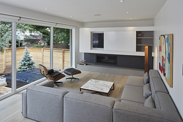 Fireplace and media centre with sliding panel