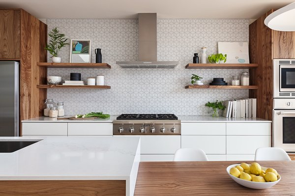 The Heath Ceramics wall tile backsplash was extended to full height and behind floating shelves to add texture and character to the minimal kitchen.