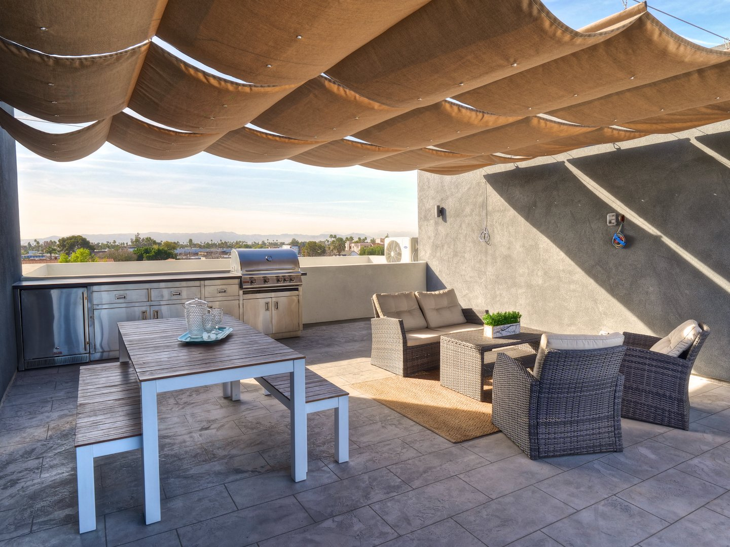 Entertain guests on your 440 sqft rooftop deck with built in barbecue and downtown Phoenix views.  Tagged: Outdoor, Rooftop, and Large Patio, Porch, Deck.  Stacks Modern by Chris Morrison