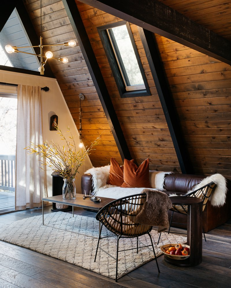 Tagged: Living Room, Sofa, Chair, Coffee Tables, End Tables, Ceiling Lighting, Pendant Lighting, and Dark Hardwood Floor.  Best Photos from Big Bear A-Frame Receives Boho Eclectic Transformation