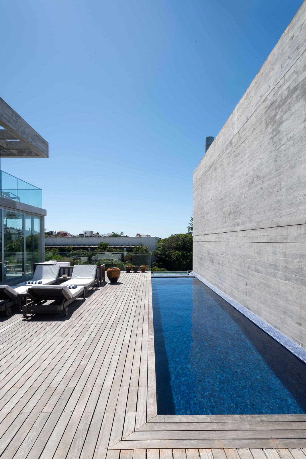 Patio/Pool Tagged: Outdoor, Side Yard, Infinity, Wood, Concrete, and Concrete.  Best Outdoor Concrete Wood Photos from La Iluminada