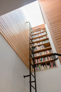 Top 5 Homes of the Week With Libraries We Love - Photo 2 of 5 - Vertical bookcase at stair landing