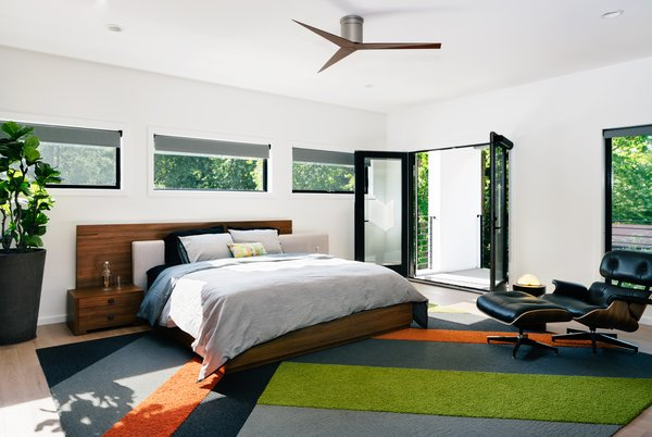 Master bedroom, with rear-facing balcony overlooking the pool beyond.