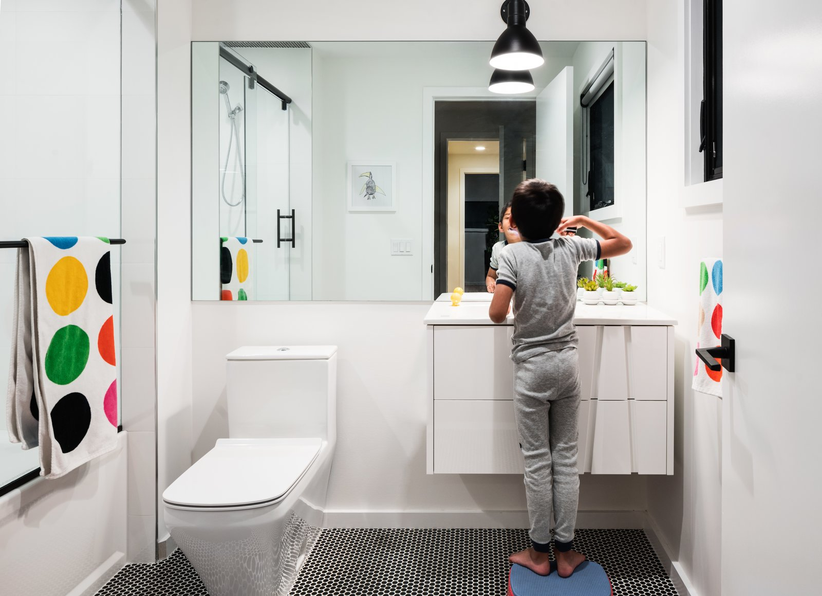 Kid's Bathroom Tagged: Bath, Engineered Quartz, Undermount, Enclosed, Ceiling, Wall, One Piece, Mosaic Tile, Alcove, Light Hardwood, and Porcelain Tile.  Best Bath Wall Alcove Photos from Roslyn Road Residence