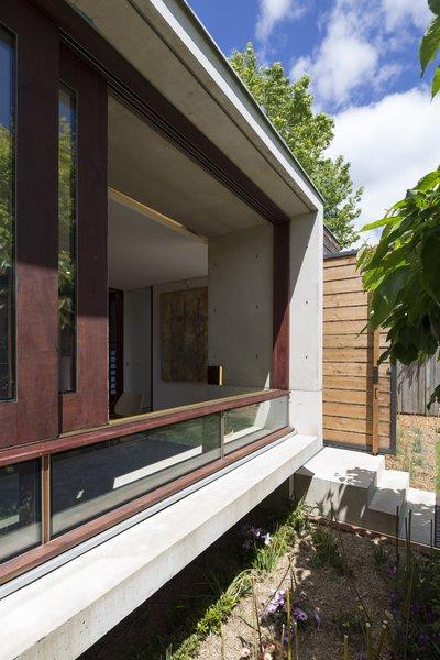 Custom river red gum sliding windows and australian cypress door.