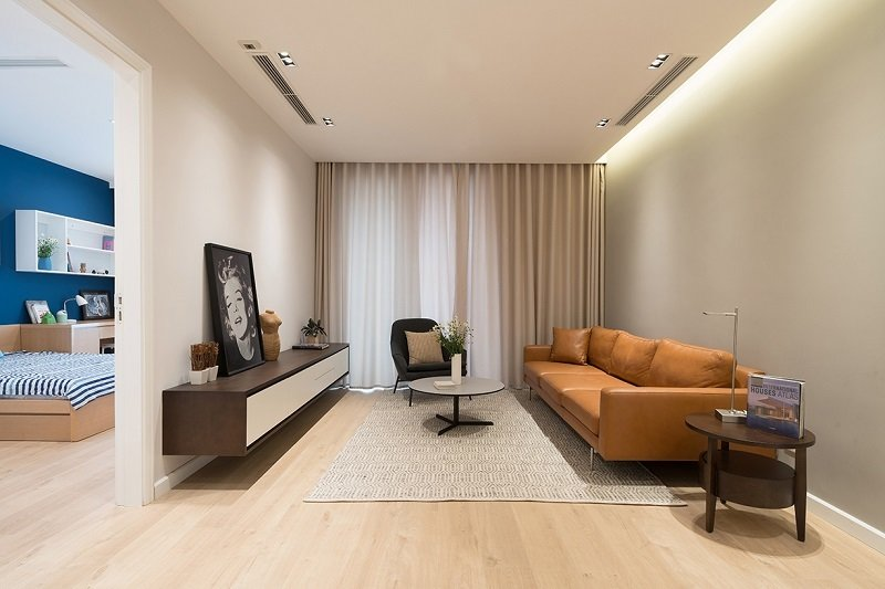 Livingroom Tagged: Living Room, Sofa, Coffee Tables, Lamps, Media Cabinet, Chair, Ceiling Lighting, and Light Hardwood Floor.  A.P01 by Đinh Công Quỳnh