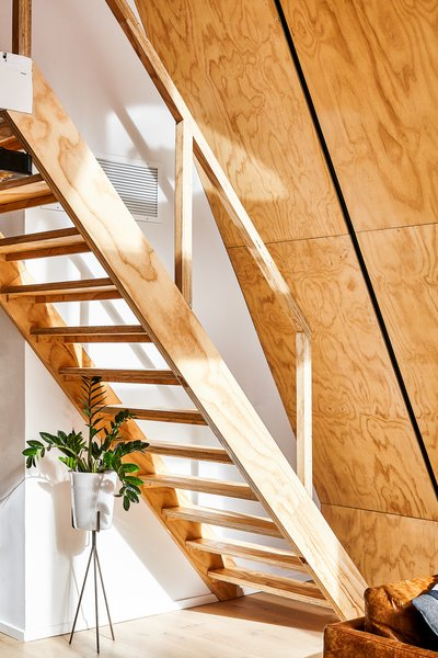 Custom stair made entirely of matching pine plywood.