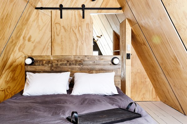 Pine plywood A-Frame interior and sliding barn door. Custom tray by Peg & Awl.