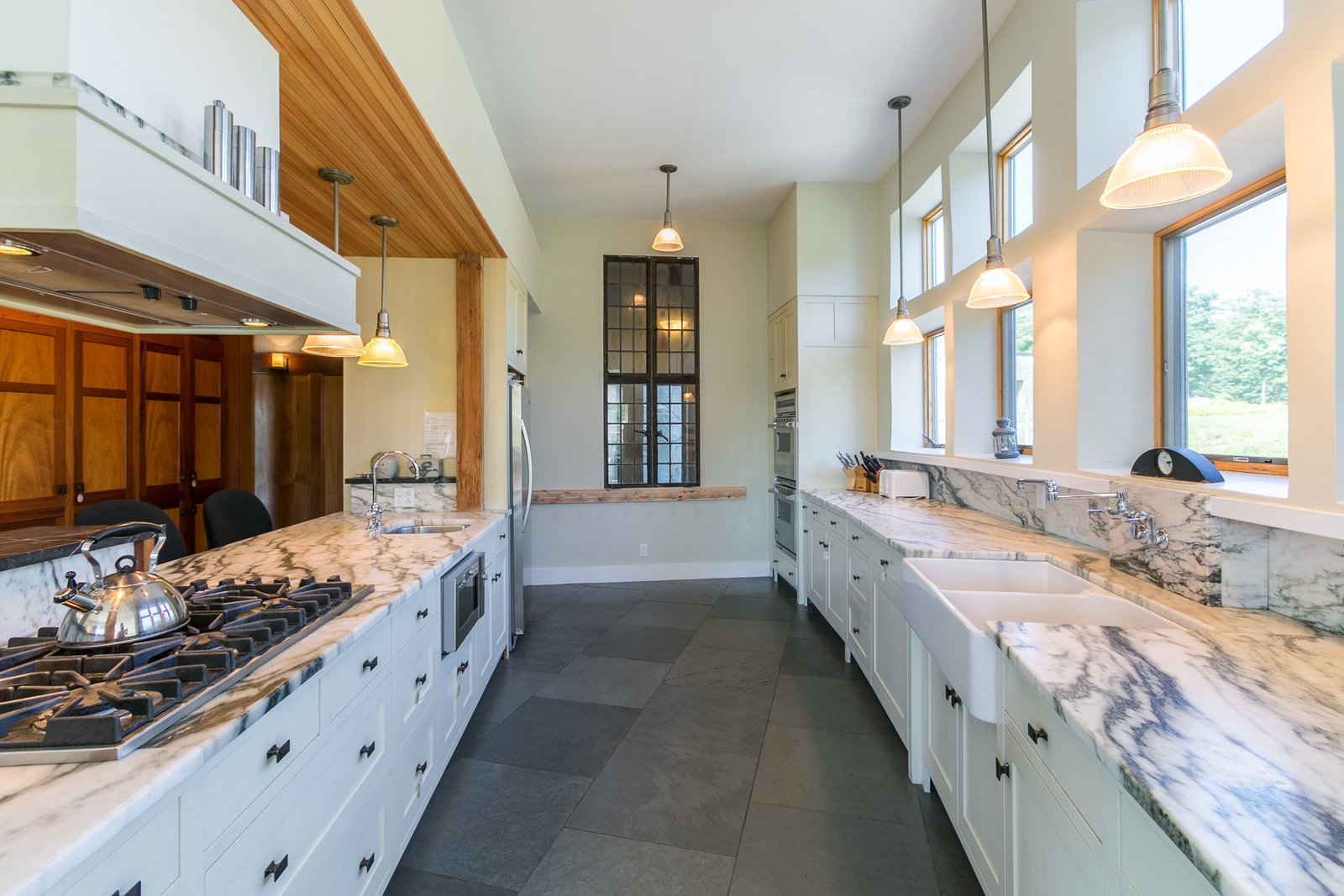 The kitchen's stunning marble countertops and slate floors.