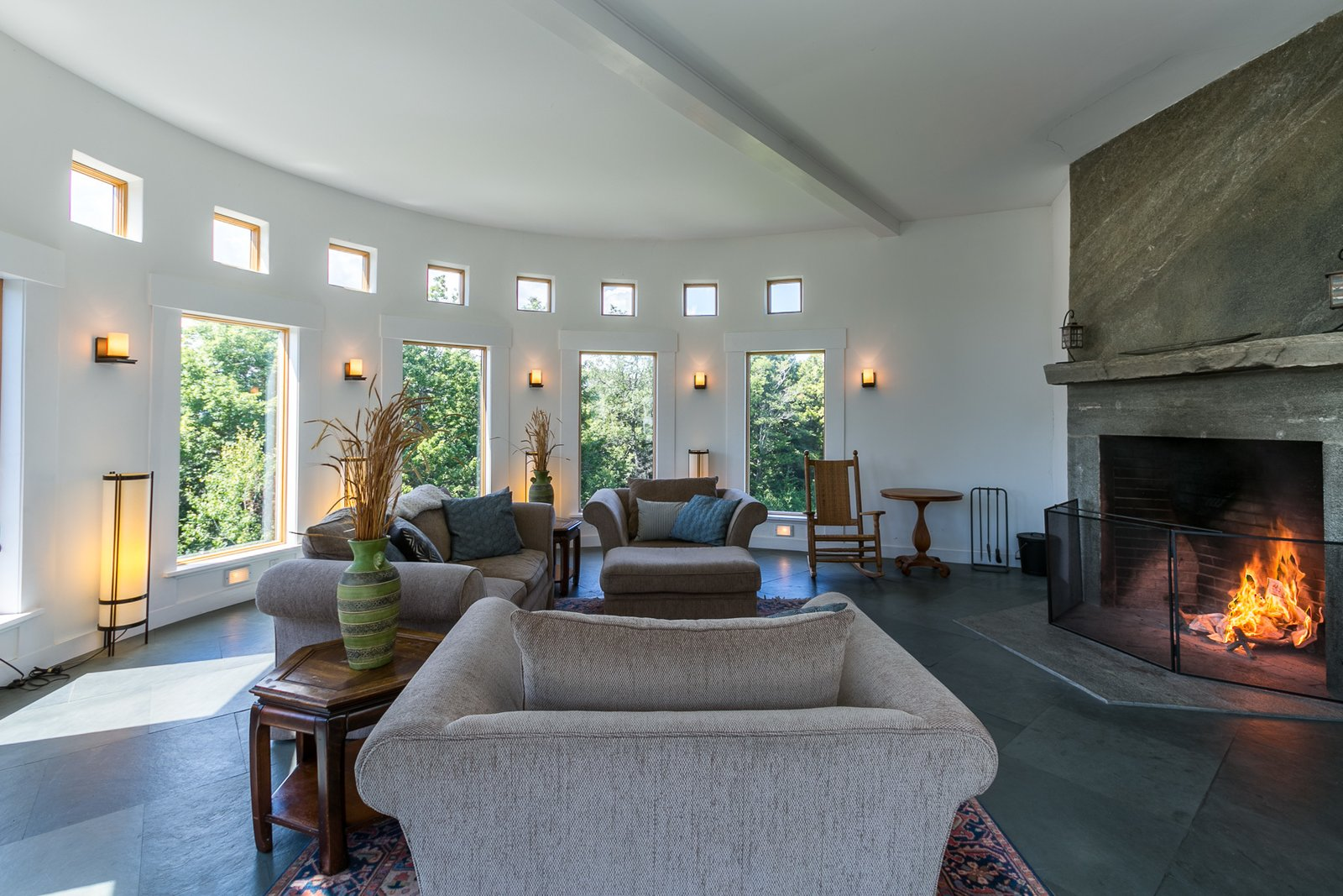 The circular living area features a granite fireplace.