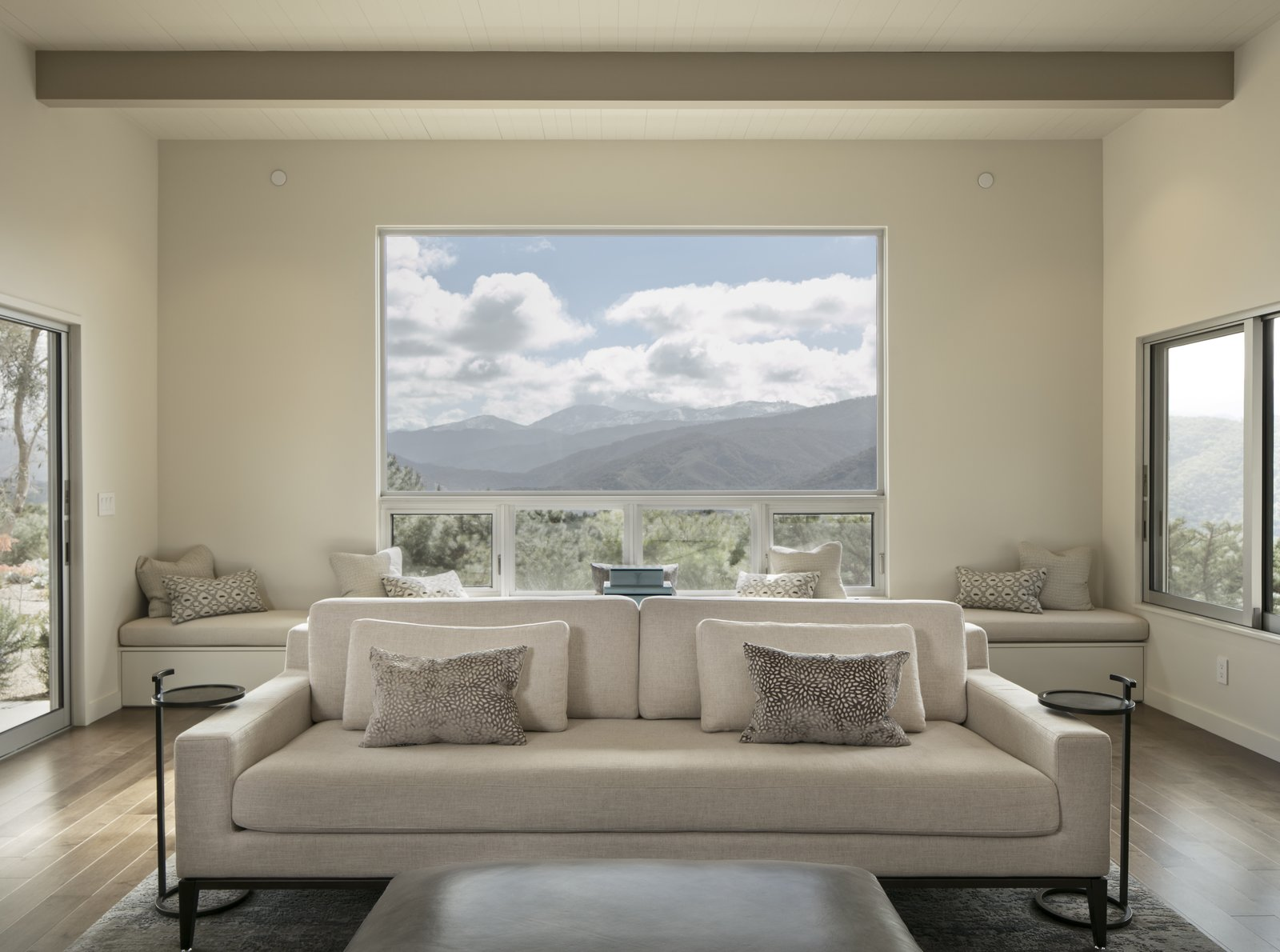 Windows on three sides of the living room take advantage of mountain and valley views.